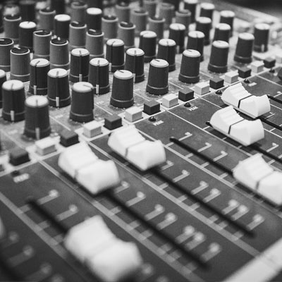 Closeup of sliders on a mixing board